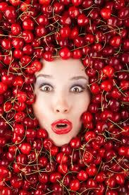 woman surrounded by cherries